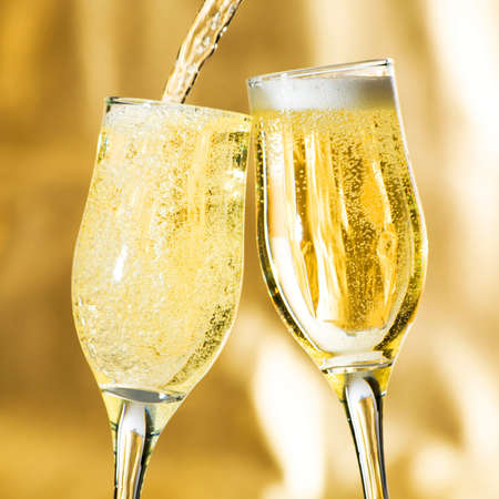champagne toast: Pair of champagne flutes making a toast.