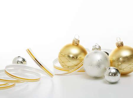 matt: Christmas balls with ribbons on white background