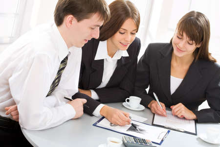 Business team at a meeting in a light and modern office environment photo