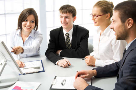 Business people at a meeting in a  modern office environment photo