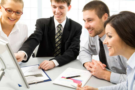 Team of people working in a office Stock Photo - 10672278