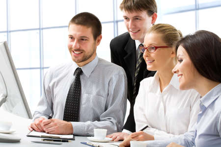 young executives: Group of young business people in a meeting at office  Stock Photo