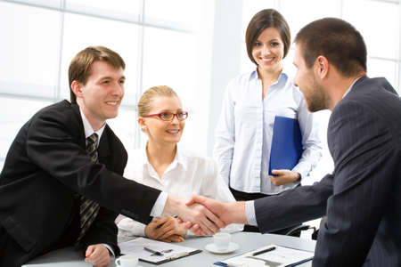 coalition: Shaking hands of two business people Stock Photo