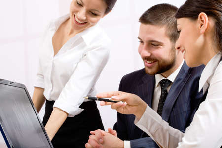 Image of three business people working at meeting Stock Photo - 10672362
