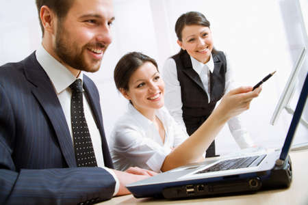 happy people: Group of happy business people in a meeting at office   Stock Photo
