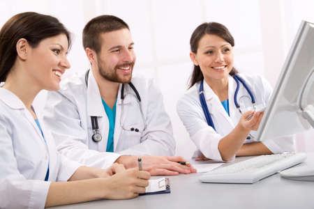 Smiling medical doctors talk on a workplace Stock Photo - 10672352
