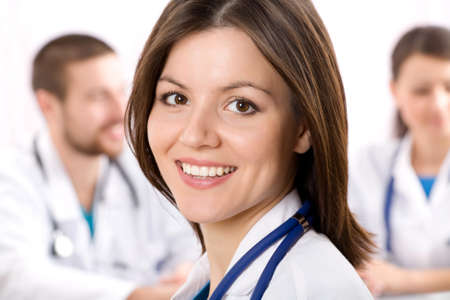 Smiling female doctor with stethoscopes  Stock Photo - 10672382