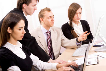 Team of people working in a office photo