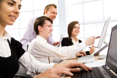 corporate buildings: Business team at a meeting in a light and modern office environment Stock Photo