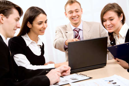 Team of people working in a office Stock Photo - 10672322