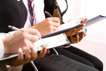sessions: Close-up of business person hand working with document
