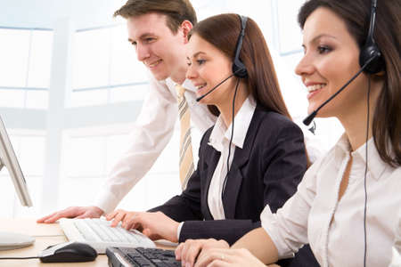 phone operator: Attractive young people working in a call center