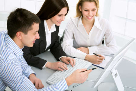 confident consultant: Three business colleagues working together