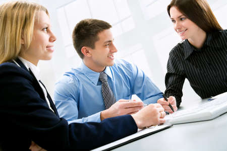 happy client: Three business colleagues working together