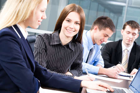 The young business woman working together with colleagues Stock Photo - 11010575