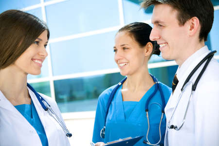 healthcare workers: Young doctors confer outside the clinic Stock Photo
