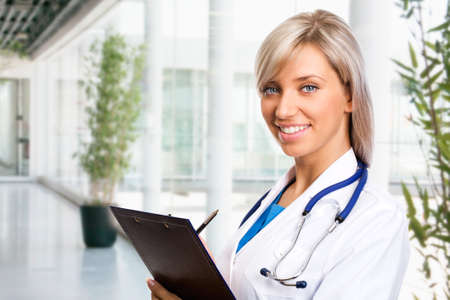 Female doctor at the holl by modern hospital Stock Photo - 11010558
