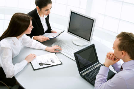 workgroup: Businesspeople work at modern office