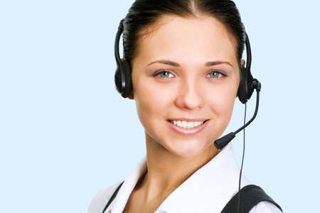 A friendly secretarytelephone operator on the blue background photo