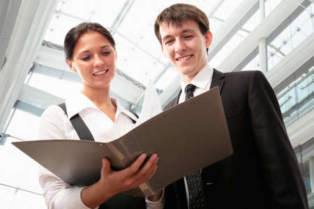 legal advice: Business partners are working together in the lobby of a modern office center Stock Photo