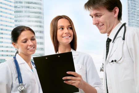 confer: Young doctors confer outside the clinic Stock Photo