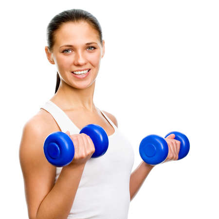 woman lifting weights: Portrait of fitness woman working out with free weights in gym