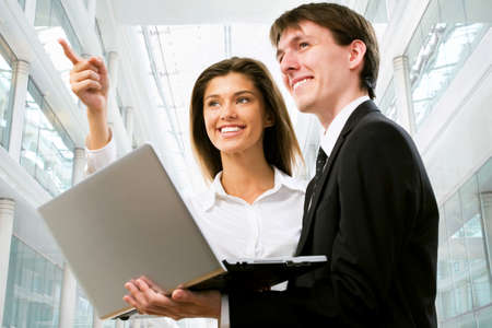 good looking woman: Happy business people in an modern office building