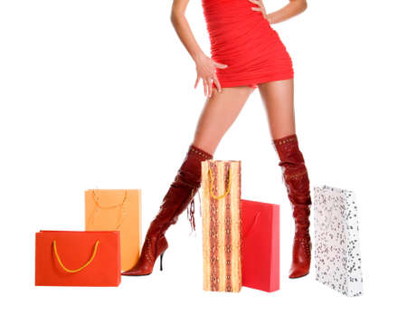 The sexual woman standing among multi-coloured bags with purchases Stock Photo - 11927041