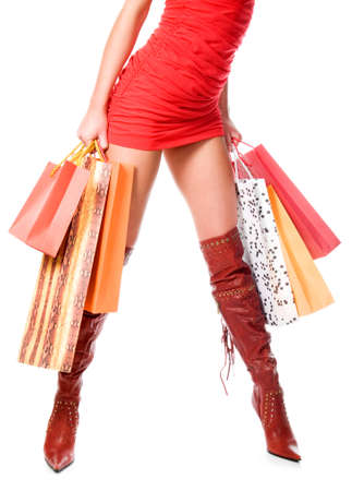 Waist-down view of woman carrying shopping bags Stock Photo - 11927156