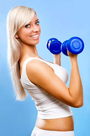 Portrait of fitness woman working out with free weights photo