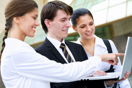 good looks: Happy business people on the background of a modern office building Stock Photo