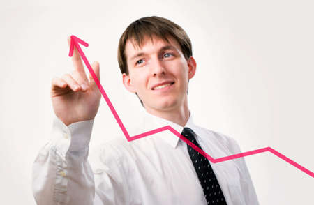 upwards: Businessman pointing on the graph in an office - focus is on graph