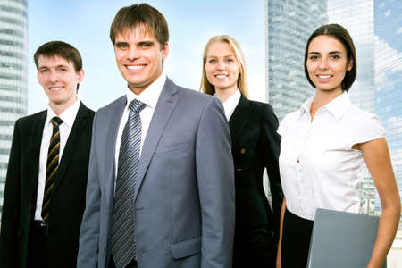 Group of business people looking at camera photo