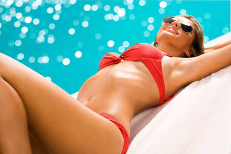 bodies of water: Sexy girl sunbathing on the beach Stock Photo