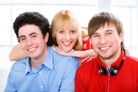 studygroup: Three young students looking at camera and smiling