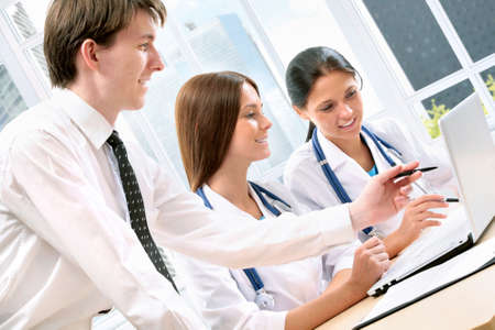 doctor computer: Young doctors in the workplace