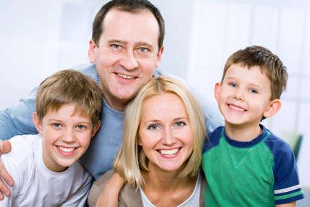mums: Happy family smiling looking at camera