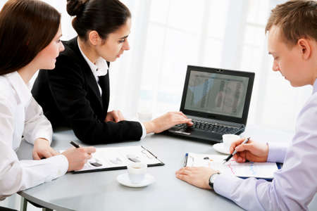 net meeting: Three business people working together at office