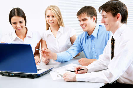 businessteam: A business team of four planning work in office