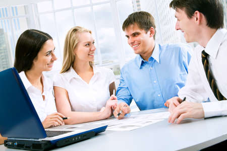 associates: Four business people working together at office Stock Photo