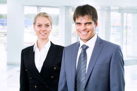 go inside: Business people standing in the lobby of a modern office Stock Photo
