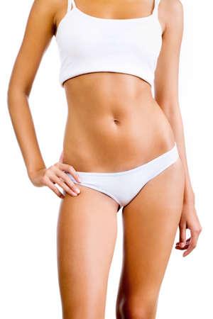 O corpo da mulher bronzeada Slim. Isolado sobre o fundo branco. Imagens