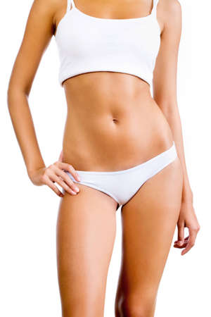 Slim tanned womans body. Isolated over white background. photo