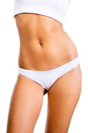 Slim tanned woman's body. Isolated over white background.   photo