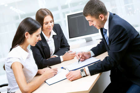 working environment: Business people working together in  office
