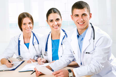 doctors smiling: Young doctors in the hospital Stock Photo