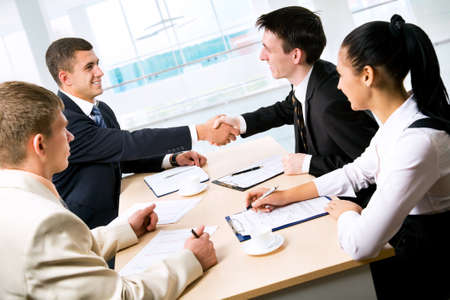 Business people shaking hands at a meeting photo