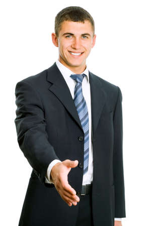 Confident businessman welcomes you on white background photo