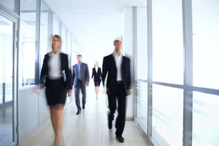 Business people walking in the office corridor Stock Photo