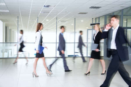 movement people: Business people walking in the office corridor